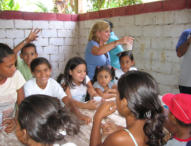 Monya Foreman helps feed the children at Mustard Seed Foundation, a ministry in a poor barrio.