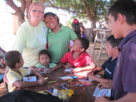 Katie Brown doing crafts with the Wayuu children at the pastors' conference in Sta. Cruz.