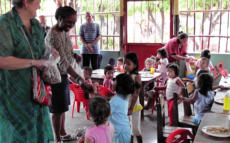 Sarita and Tonia give out toys in Rosa's Kindergarten