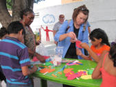 Tonia & Sandra do crafts with the kids in the Children's Home.