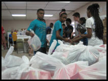 Youth from the Hope Scholarship program helping out.