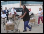 Volunteers brought the boxes out from the Bargain Center in the early years.