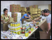 Packing assembly line. These volunteers came all the way from Venezuela! (2012)