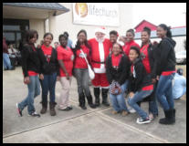 Delta Gems got to pose with Santa.